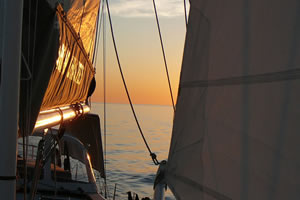 Sailing in the sunset off the W.A. Coast on a chartered yacht